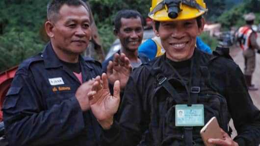 Rescue workers along the main road leading to Tham Luang Nang Non cave as the first 2 ambulances carrying 2 boys pass by on July 8, 2018 in Chiang Rai, Thailand. Divers began an effort to pull the 12 boys and their soccer coach on Sunday morning after they were found alive in the cave at northern Thailand.