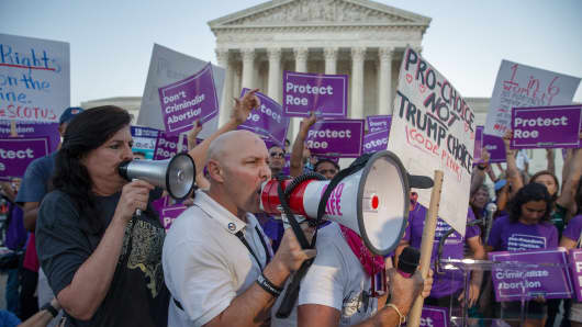 Pro-choice and anti-abortion protesters demonstrate in front of the U.S. Supreme Court on July 9, 2018 in Washington, DC.