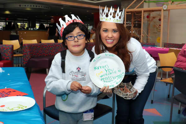 Cara Mund, Miss America 2018 receives a gift from one of the children at Children's Hospital of Philadelphia on April 6, 2018 in Philadelphia, Pennsylvania.