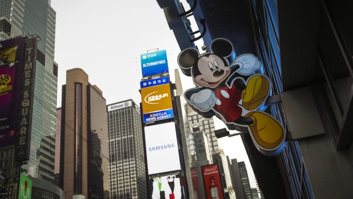 An image of Mickey Mouse, the official mascot of The Walt Disney Company, is displayed outside the Disney Store in Times Square in New York City.