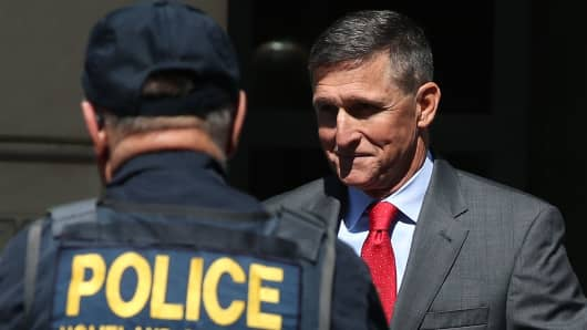Michael Flynn, former national security advisor to U.S. President Donald Trump, walks out of the E. Barrett Prettyman Federal Courthouse after a status hearing July 10, 2018 in Washington, DC.
