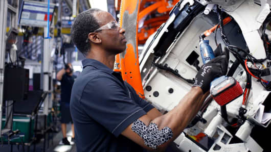 A worker assembles a vehicle at the BMW plant in Greer, South Carolina.
