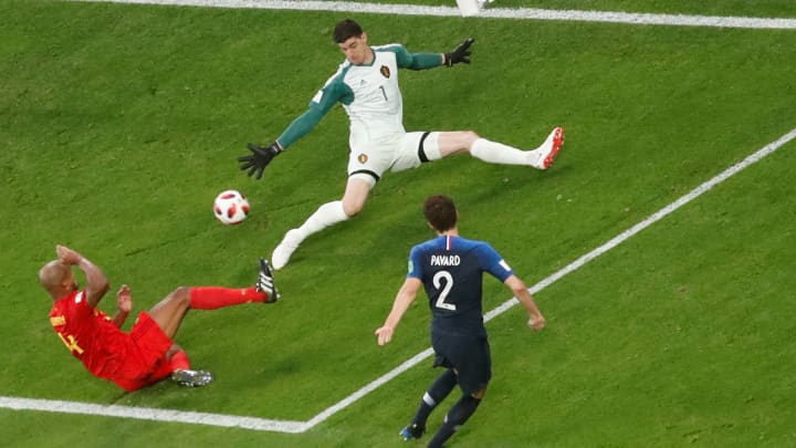 Belgium's Thibaut Courtois makes a save from France's Benjamin Pavard in the World Cup Semi Final match at Saint Petersburg Stadium, Saint Petersburg, Russia.
