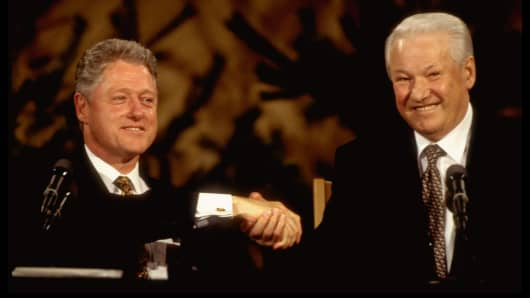 US Pres. Bill Clinton (L) & Russian Pres. Boris Yeltsin warmly shaking hands, all-smiles during summit press conference in March of 1997 in Finland.