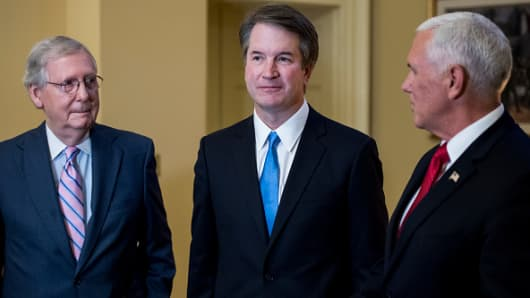 From left, Senate Majority Leader Mitch McConnell, R-Ky., Supreme Court nominee Brett Kavanaugh, and Vice President Mike Pence meet in McConnell's office in the Capitol on Tuesday, July 10, 2018, the day after President Donald Trump nominated Kavanaugh to the Supreme Court.