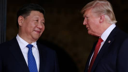 President Donald Trump welcomes Chinese President Xi Jinping at Mar-a-Lago state in Palm Beach, Florida, U.S., April 6, 2017.