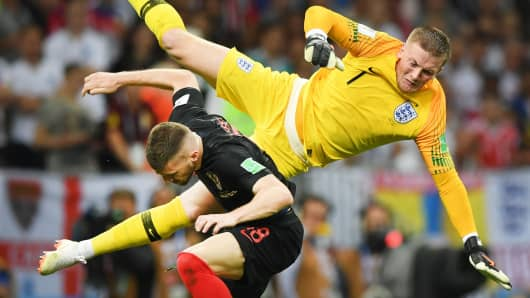 Jordan Pickford of England collides with Ante Rebic of Croatia during the 2018 FIFA World Cup Russia Semi Final match between England and Croatia at Luzhniki Stadium on July 11, 2018 in Moscow, Russia.