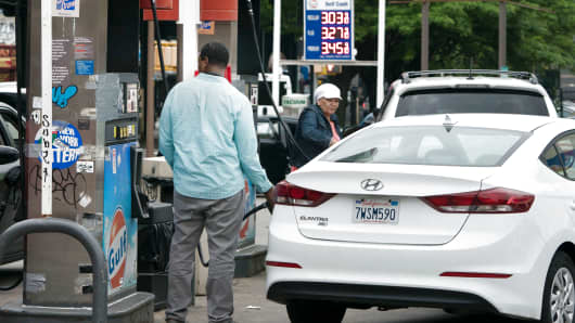 Customers pump gasoline at a gas station in the Bronx, where gas prices are over $3.00 per gallon,  June 1, 2018 in New York.