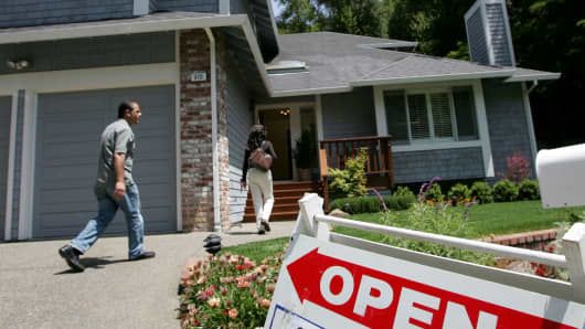 real estate agents arrive at a brokers tour showing a house for sale with a list