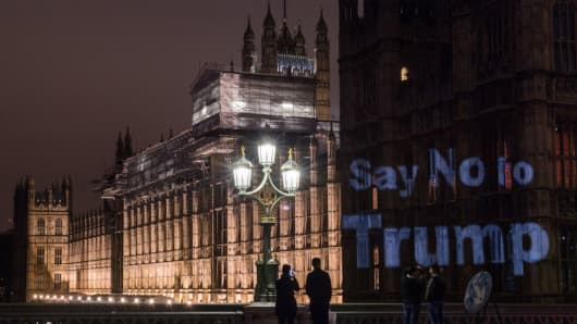 A slogan reading 'Say no to Trump' is seen projected on the Houses of Parliament, the evening before a parliamentary debate on Donald Trump's state visit is due to take place, on February 19, 2017 in London, England.
