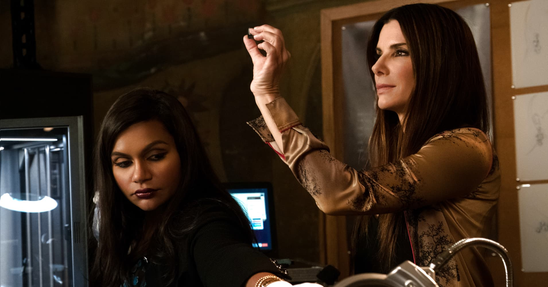 "Mindy Kaling (left) as Amita and Sandra Bullock (right) as Debbie Ocean in Warner Bros. Pictures' and Village Roadshow Pictures' ""OCEANS 8,"" a Warner Bros. Pictures release."