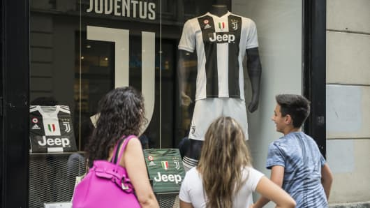 Juventus fans buy the shirt of Cristiano Ronaldo in the Juventus Store.