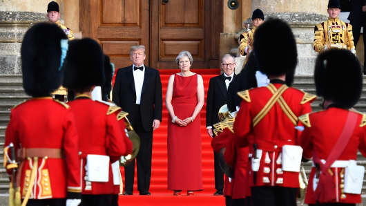 Britain's Prime Minister Theresa May and her husband Philip May greet U.S. President Donald Trump, First Lady Melania Trump at Blenheim Palace on July 12, 2018 in Woodstock, England.