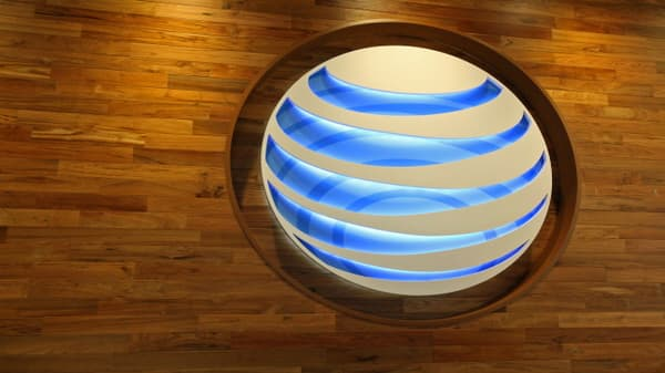 AT&T downgraded to 'market perform' as DOJ targets deal