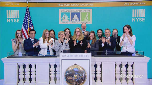 Guests of Dysautonomia International ring in Friday's trading session at the NYSE