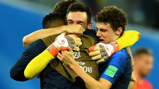 France's Hugo Lloris, Benjamin Pavard and teammates celebrate after the match against Belgium, July 10, 2018.