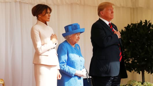 President Donald Trump and the First Lady Melania Trump are met by Britain's Queen Elizabeth as they arrive for tea at Windsor Castle in Windsor, Britain, July 13, 2018.