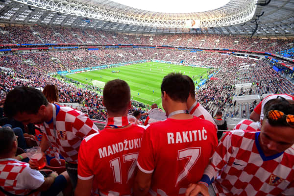 Croatia supporters stand in the tribunes prior to the Russia 2018 World Cup semi-final football match between Croatia and England at the Luzhniki Stadium in Moscow on July 11, 2018.