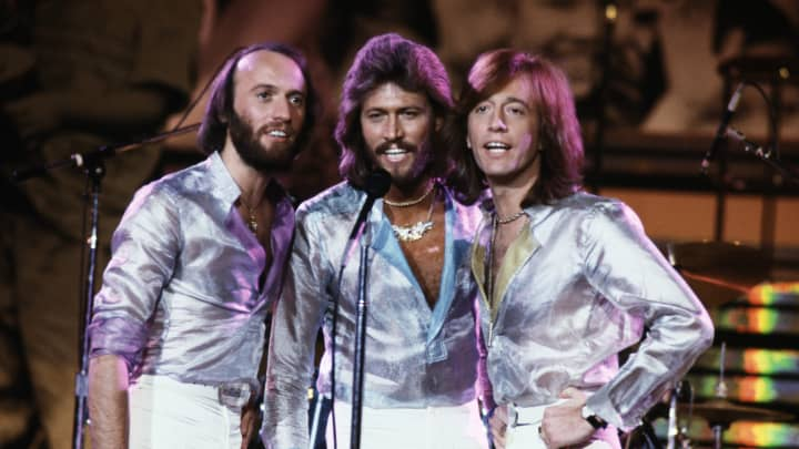 Vocal trio the Bee Gees performing at the Music for UNICEF Concert at the United Nations General Assembly in New York City, January 1979. Left to right: Maurice, Barry, and Robin Gibb.