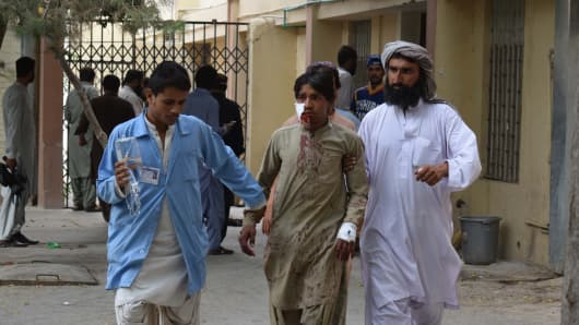 A victim of a bomb blast is brought to a hospital in Quetta on July 13, 2018 following an attack at an election rally.