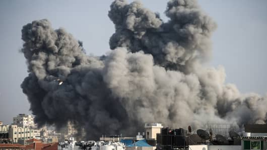 Smoke rises after Israeli fighter jets carried out airstrike to a building in Al Katiba region in Gaza City.  Israel's military said it had launched air strikes targeting Hamas in the Gaza Strip on July 14 as rockets and mortars were lobbed into southern Israel from the blockaded Palestinian enclave.