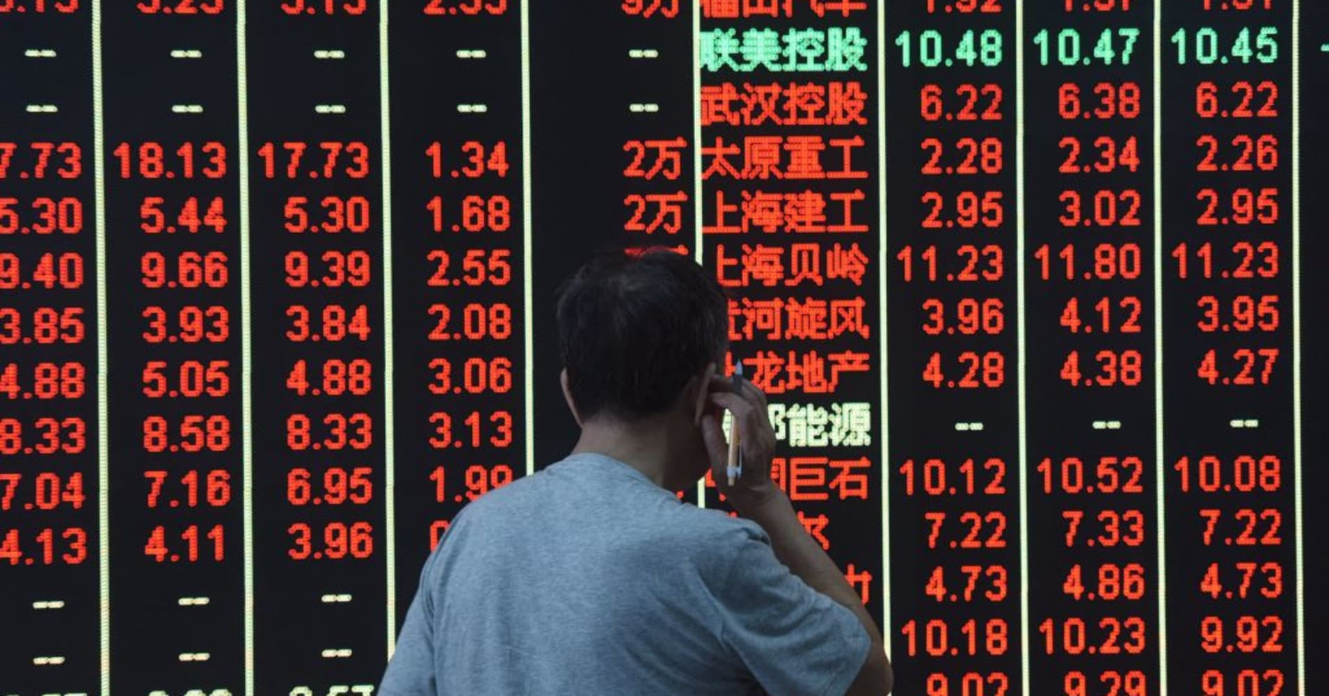 Asian stocks slip, shrugging off firmer Wall Street lead as investors digest China data