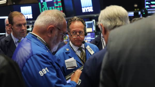 Traders work on the floor of the New York Stock Exchange on July 12, 2018 in New York City.