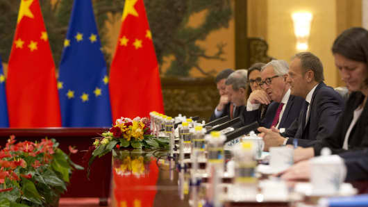 European Council President Donald Tusk (2nd R) and European Commission President Jean-Claude Juncker (3rd R) attend a meeting with China's Premier Li Keqiang (not pictured) at the Great Hall of the People in Beijing on July 16, 2018