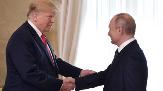 President Donald Trump  and Russia's President Vladimir Putin shake hands during a meeting at the Presidential Palace in Helsinki, July 16, 2018.