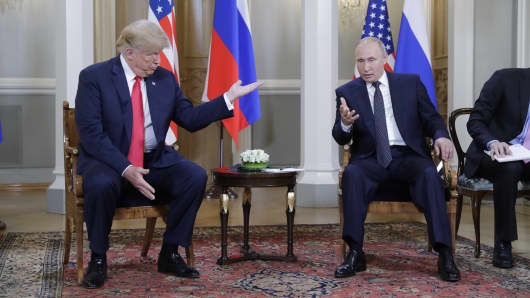 President Donald Trump (L) and Russia's President Vladimir Putin talk during a meeting at the Presidential Palace in Helsinki, July 16, 2018.