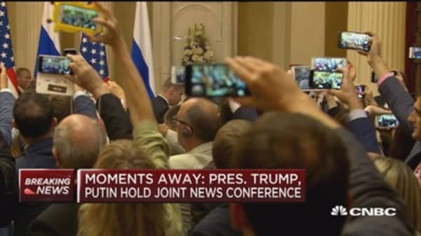Reporter escorted out of Trump-Putin news conference