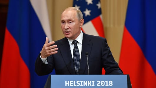 Russia's President Vladimir Putin speaks during a joint press conference with President Donald Trump at the Presidential Palace in Helsinki, on July 16, 2018.