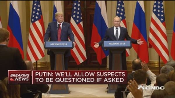 Trump doesn't denounce Russia for election interference, asks about Clinton emails and DNC server