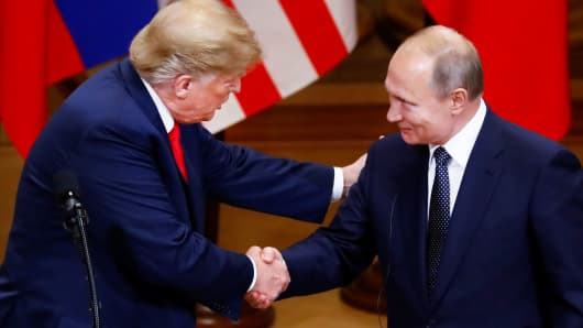 President Donald Trump and Russian President Vladimir Putin shake hands as they hold a joint news conference after their meeting in Helsinki, Finland, July 16, 2018.