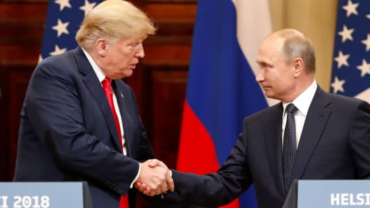 President Donald Trump and Russian President Vladimir Putin shake hands as they hold a joint news conference after their meeting in Helsinki, Finland July 16, 2018.