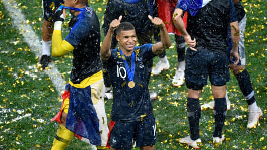 France's forward Kylian Mbappe, center, celebrates during the trophy ceremony after winning the Russia 2018 World Cup final football match between France and Croatia at the Luzhniki Stadium in Moscow on July 15, 2018.