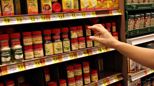 A shopper reaches toward a display of McCormick spices and flavorings in an Associated Supermarket in 2005.