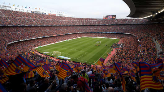 Fans cheer before the Spanish league football match between FC Barcelona and Real Sociedad at the Camp Nou stadium in Barcelona, Spain, on May 20, 2018.