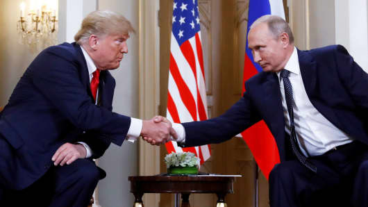 President Donald Trump and Russia's President Vladimir Putin shake hands as they meet in Helsinki, Finland July 16, 2018.