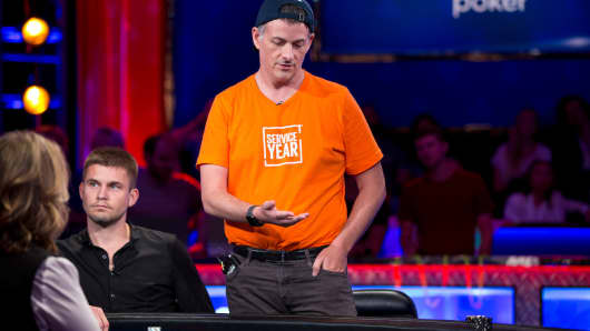 "Hedge fund billionaire David Einhorn plays poker at the World Series of Poker's ""Big One for One Drop."""