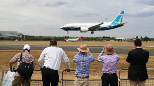 Spectators watch a Boeing Co. 737 Max 7 jetliner land on the opening day of the Farnborough International Airshow 2018 in Farnborough, U.K., July 16, 2018.
