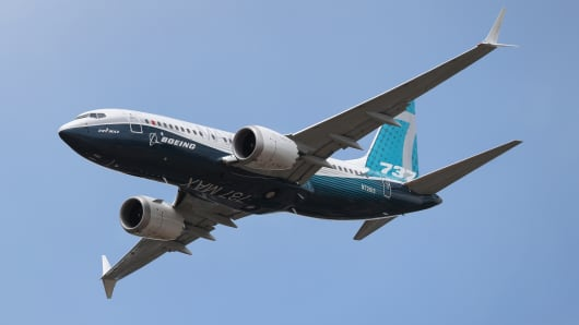 A Boeing 737 Max gives a display during the opening day of the Farnborough International Airshow in Hampshire.