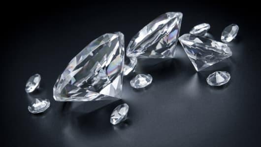 Few, huge diamonds scattered on black background