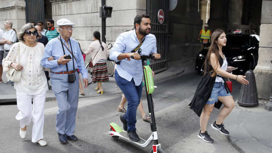 A man rides an electric scooter Lime-S from the bike sharing service company 'Lime.'