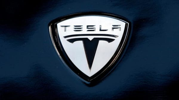 Tesla Shares Fall After Needham Downgrades To Sell Citing Possible