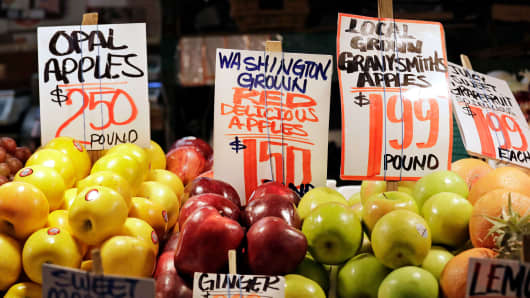 Apples grown in Washington state are displayed for sale at the Pike Place Market in Seattle.
