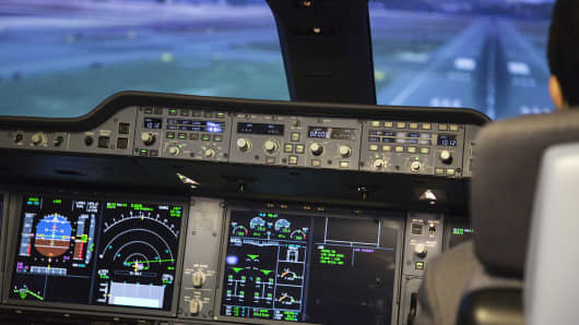 Instrument panels and screens are seen inside an Airbus SE A350 XWB full-flight simulator.