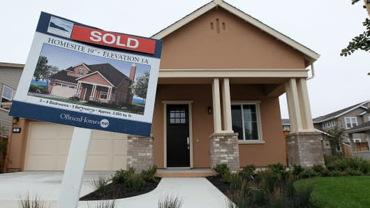 A sold sign is posted in front of a new home in a housing development April 23, 2010 in Pacifica, California. Sales of new homes surged nearly 27 percent in March, the largest single-month increase in 47 years.