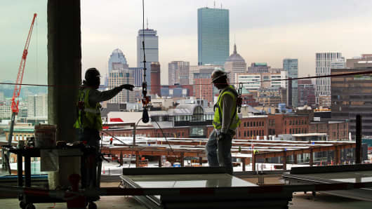 Building Pathways, an organization that creates opportunities for low-income area residents to access and prepare for building trades in the construction industry tours Skanskas 121 Seaport construction site in Boston on May 24, 2017.