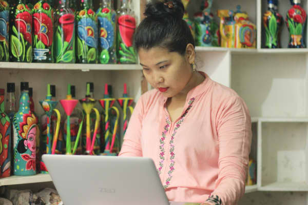 A merchant in Bangladesh sells her painted pottery on ShopUp's online platform.